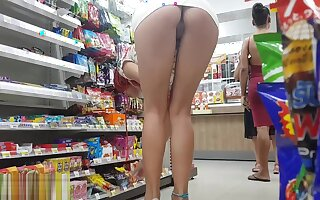 Perfect Ass Bends in Shop and Demonstrates Pussy - Public