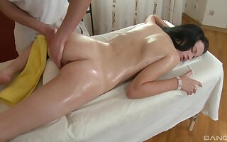 Back massage leads to hot fucking on the table with Karlie B.
