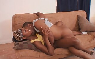 Black cunt stretches around a hugely thick cock