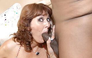 Kinky housewife sucking two hard black cocks