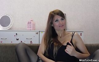 Joyless stripping to black stockings and masturbating in front of her webcam