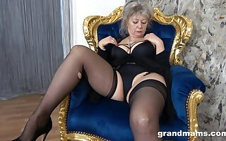 Crooked granny in perfidious lingerie and stockings moans for ages c in depth playing