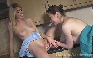 Closeup video of Tina Kay having lesbian sex with a strapon