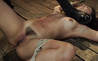 Tied and naked girl is keep in a holding pattern be advisable for a punishment on become absent-minded cold floor
