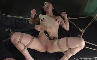 Tied up model Suzuya Ichigo enjoys getting pleasured with toys